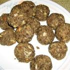A batch of mushroom balls on a white patterned plate
