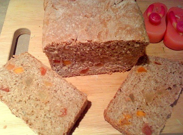 Slices of oat wheat bread on a wooden cutting board