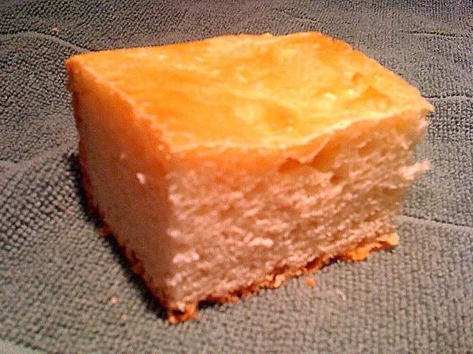 A square of ciabatta bread on a dark background