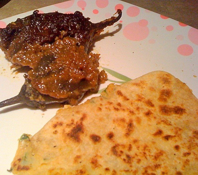 Aloo Paratha on a white and pink patterned plate