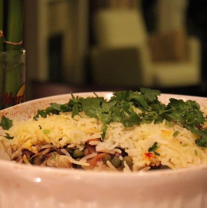 A 3 layer garlicky veg biryani in a deep white bowl