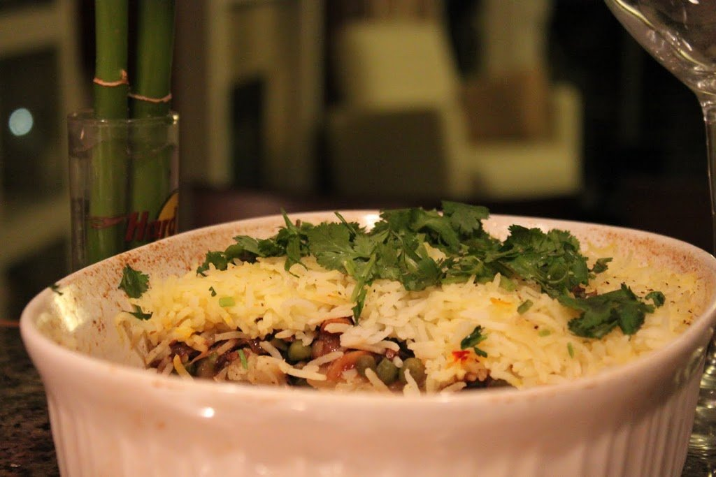 A 3 layer garlicky veg biryani. Packed full of delicious vegetables and spices and topped with fresh cilantro. Serve with hot Raita. Vegan and Gluten Free Recipe. #glutenfree #veganricha #vegan