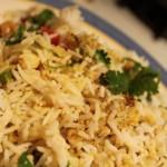 A close up of a plate of mughlai veggie biryani