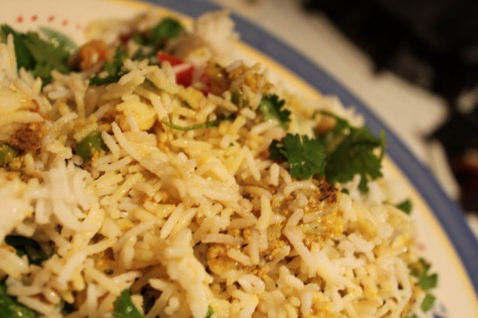 A close up of a plate of mughlai veggie biryani