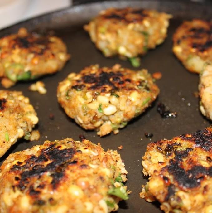 Sprouts potato cutlets on a black plate