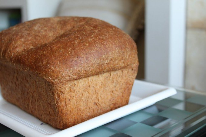 A loaf of mung sprouts wheat bread on a white plate