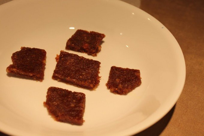 Squares of date fig burfi on a white plate