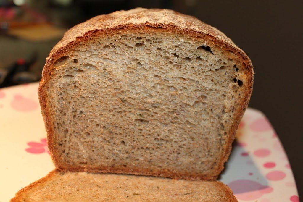 A loaf of mint almond wheat bread with the end sliced off
