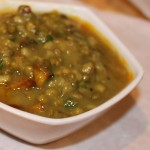 Green mung dall served in a white bowl