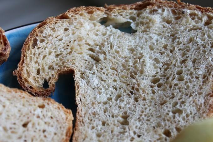 slices of lemony multigrain loaf on a blue plate