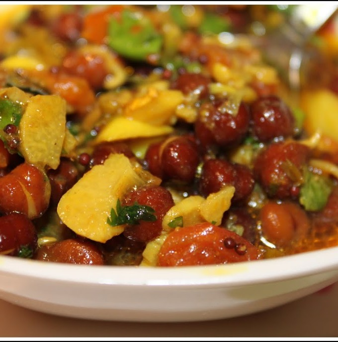 A bowl of sprouted black chickpea curry
