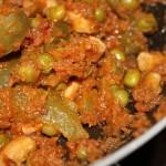A close up of tomato cilantro curry
