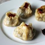 Shu Mai dumplings served on a white plate