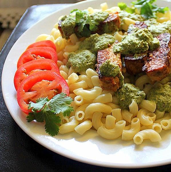 Pasta with Spicy Blackened Tempeh and Cilantro Almond Pesto. A delicious and simple pasta dish made with a creamy almond pesto. Vegan and Gluten Free.#glutenfree #veganricha #vegan