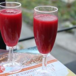 Two glasses of mango beet spiced cooler