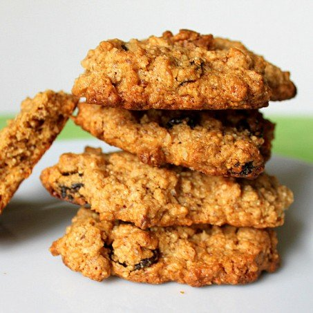 A stack of quinoa oatmeal raisin cookies on a white background