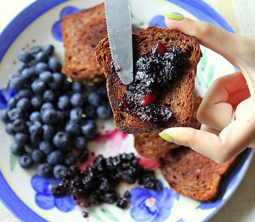 Jam being spread on french toasts