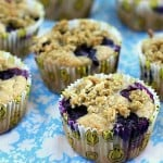 Lemon Blueberry Multigrain Muffins on a blue and white tablecloth