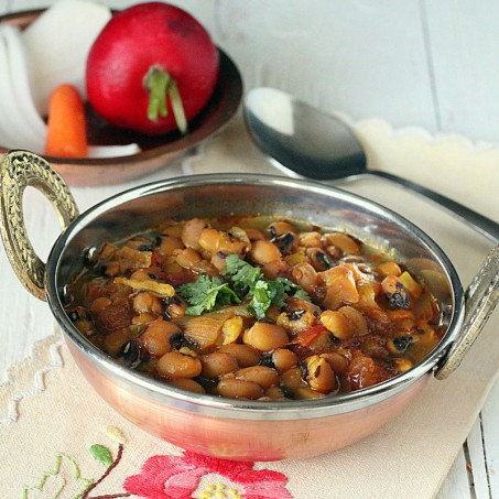 Black eyed peas curry served in a copper bowl with cilantro garnish