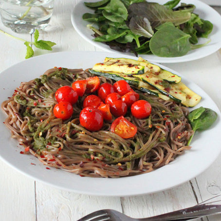 Buckwheat Soba pasta with grilled Zucchini, evoo, pesto, cherry tomatoes. Vegan, glutenfree