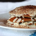 Vegan tiramisu pancakes stacked on a white plate