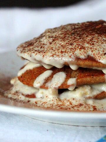 Vegan tiramisu pancakes stacked on a white plate