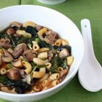 mushroom rainbow chard shallot soup served in a white bowl