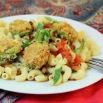 Breaded Brussels sprouts served on top of a plate of pasta