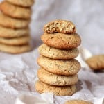 Satsuma multigrain cookies stacked on parchment paper