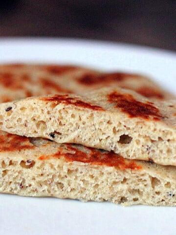A close up of vegan gluten free naan cut in half