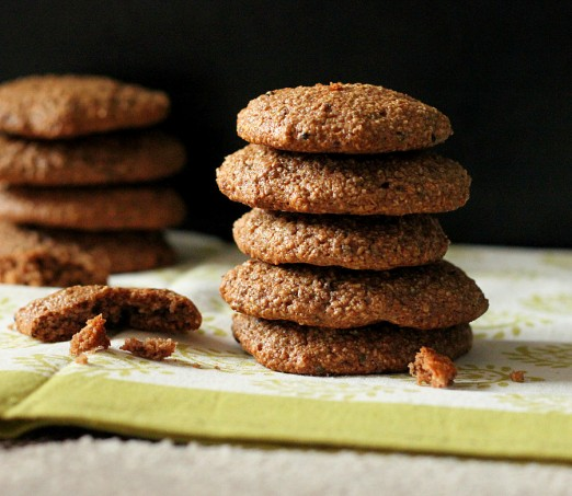 A stack of chocolate quinoa oat cookies on a dark background