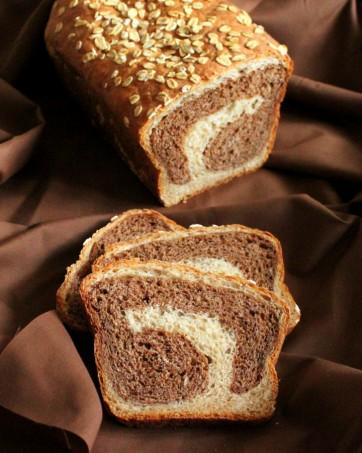 Vanilla wheat bread cut in half on a fabric background