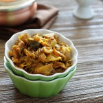 Spiced cabbage and potato in a small green bowl