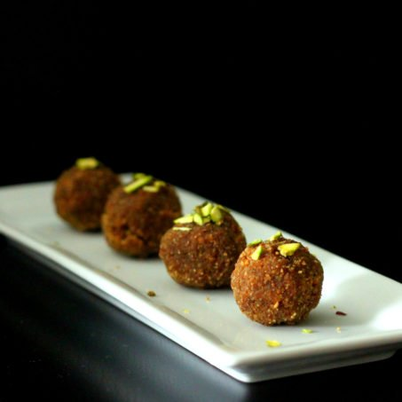 wheat ladoo served on a white oblong plate
