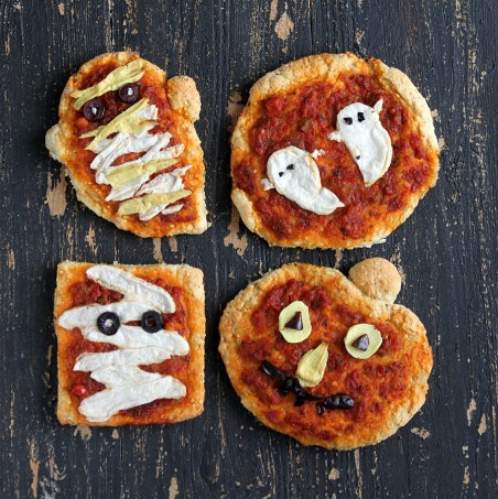 Halloween Pizzas: Ghosts, Pumpkins and Mummies with coconut milk Mozzarella, Cheddar, Sundried Tomato Marinara on Sesame Barley crust. vegan recipe