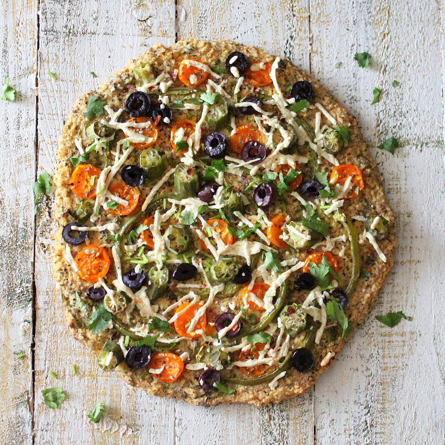 Kale Millet Chickpea quiche Pizza topped with okra, tomatoes and olives | Vegan Richa