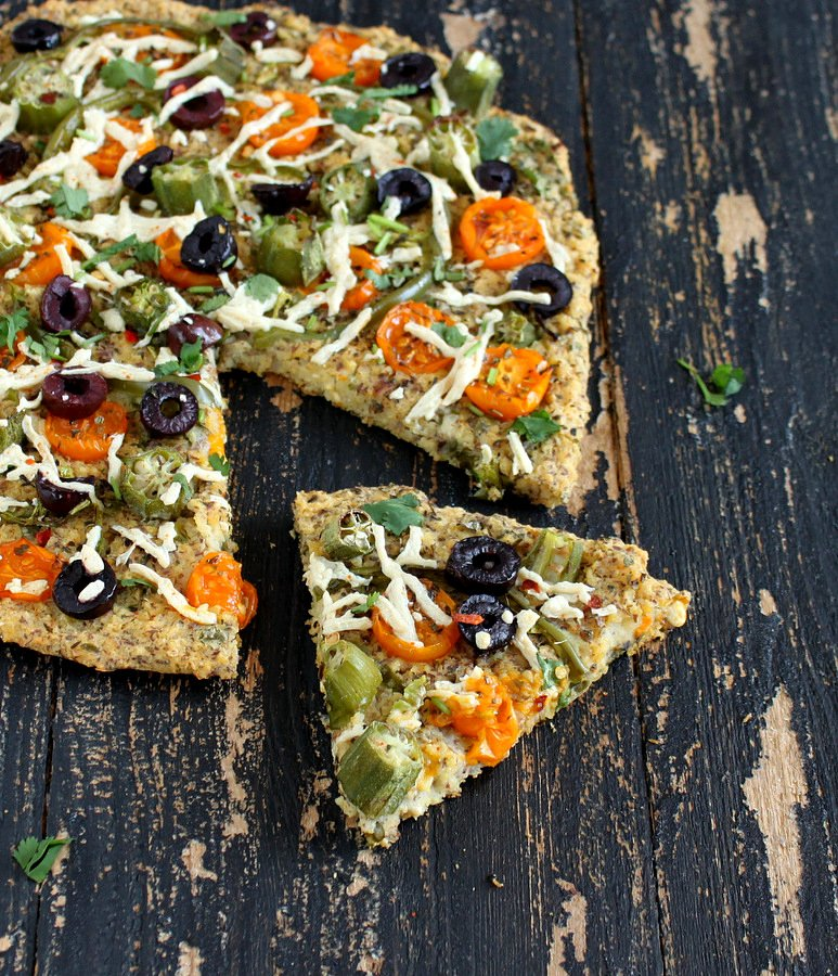 Millet Kale Chickpea Quiche Pizza topped with Okra, golden cherry tomatoes, bell peppers. glutenfree vegan recipe