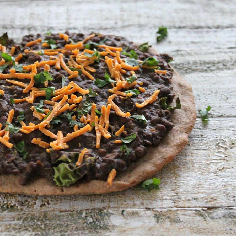 Missir Wot Pizza - Ethiopian Red lentil stew and Kale on Gluten free teff pizza crust. Gluten-free Pizza with ethiopian lentil topping. | VeganRicha.com #vegan #glutenfree #recipe