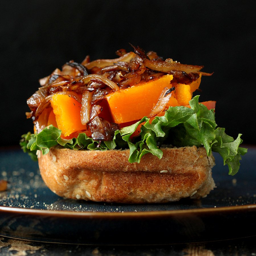 This roasted Butternut squash slider has balsamic caramelized onions and sriracha mayo. | VeganRicha.com #vegan #burger #slider