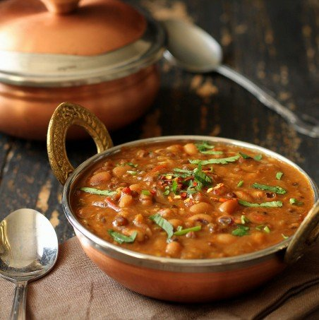 This daal has whole green mung bean and Black eyed Peas. When cooked together, the mung bean gets mushy and makes for a thick gravy.
