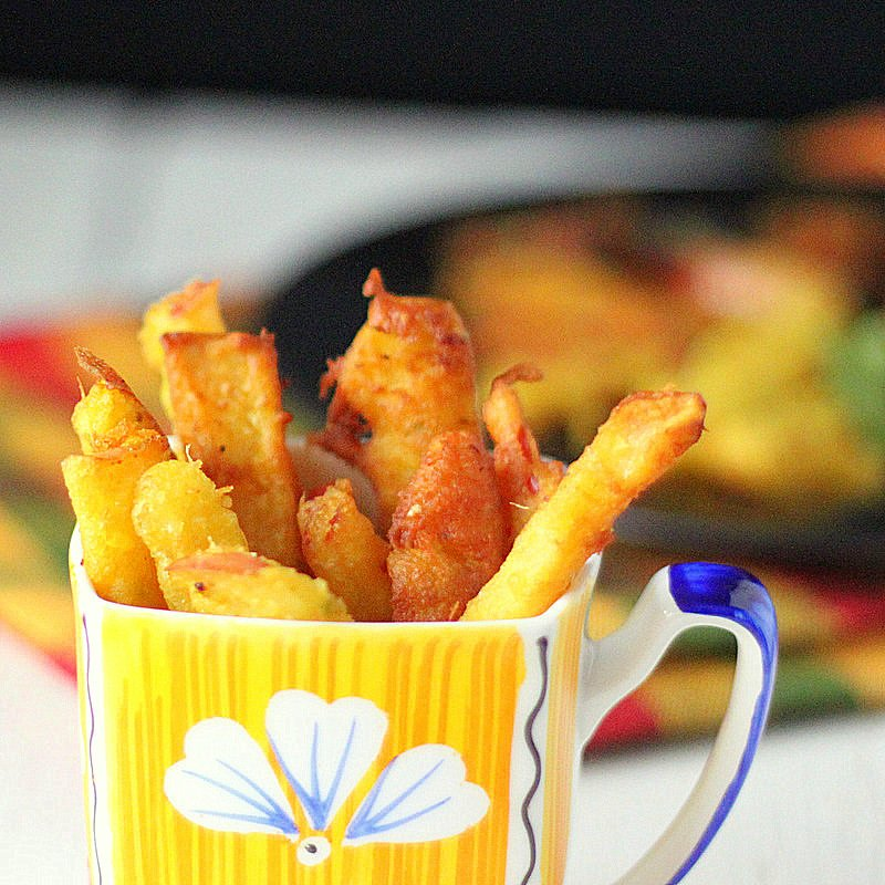 Delicious apple fritters (fries). Apple covered in some thick and spicy Chickpea batter and fried to a crisp golden brown. Vegan Recipe. #glutenfree #veganricha #vegan