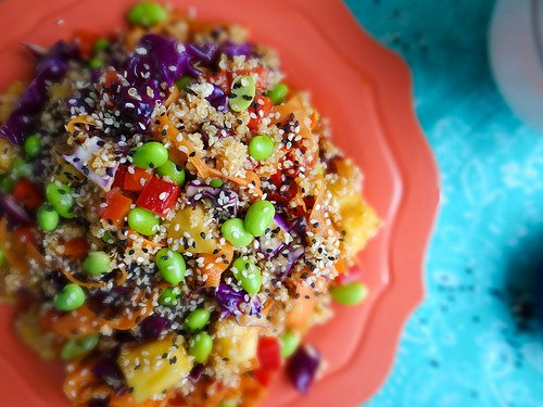 Bitter & Sweet Asian Salad with quinoa, carrot, pineapple, cabbage, and edamame