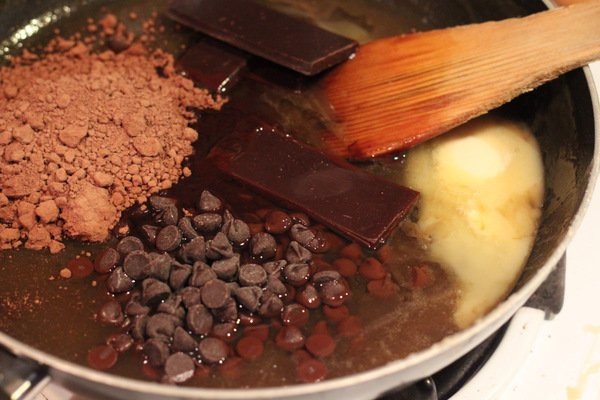 chocolate chips, chocolate and cocoa powder being added combined to make vegan brownies