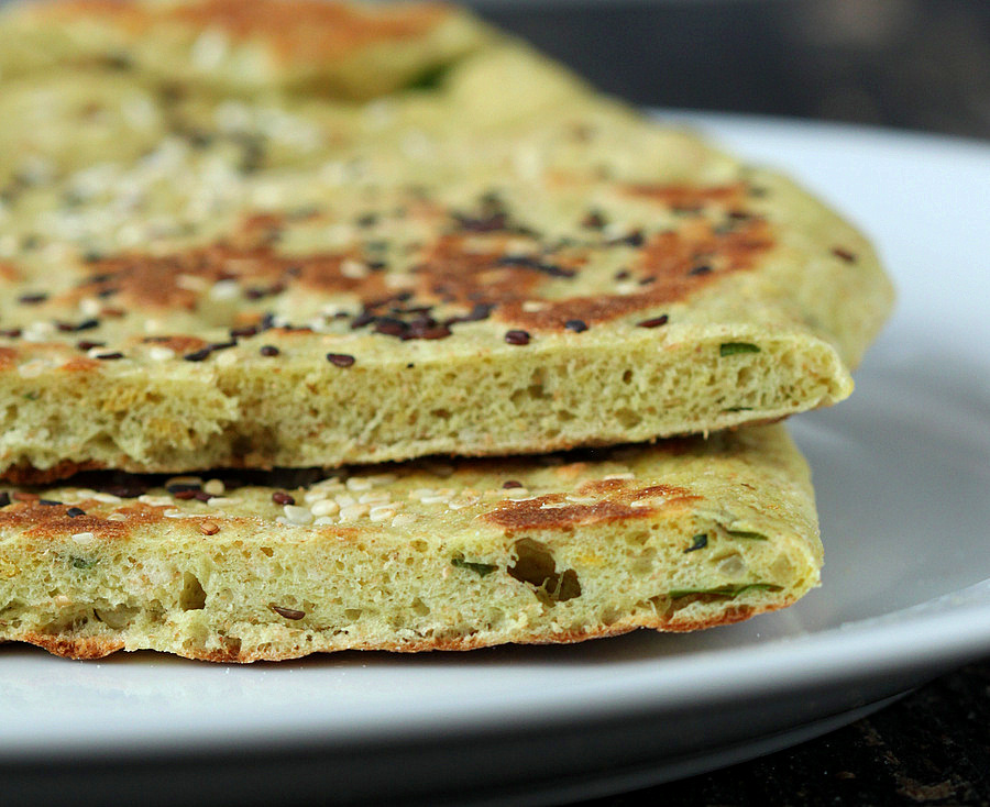 This Oil-free Avocado Naan does not need yogurt. Avocado adds the moisture and fat to keep this flat-bread moist for days. | VeganRicha.com #vegan #flatbread