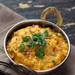 vegan mung dal in a sliver Indian serving bowl