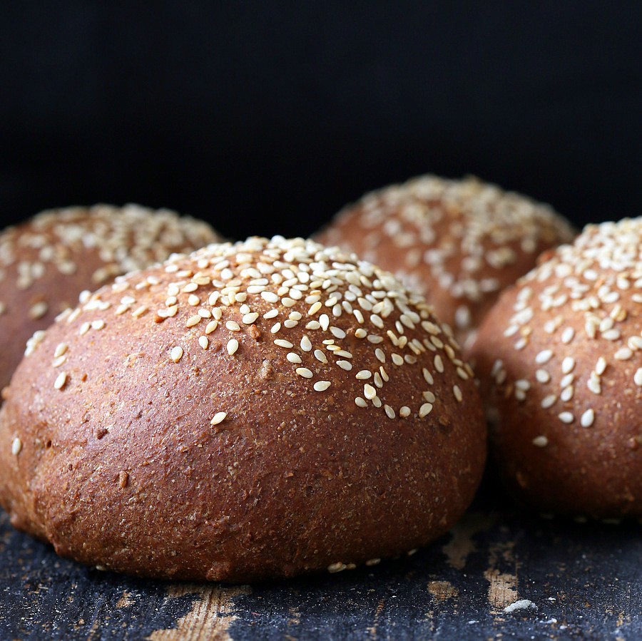 side view of vegan burger buns sprinkled with sesame seeds