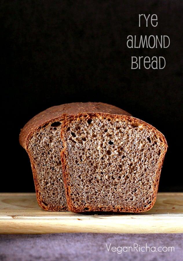 side view of vegan rye almond flour sandwich bread on a wooden board