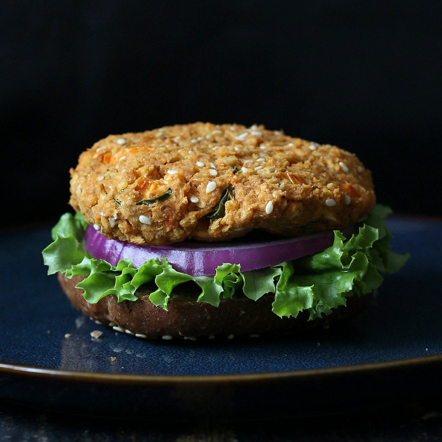 BBQ Lentil Veggie Burger with Mango Carrot Slaw and barbecue sauce. Serve as burgers or over a crisp salad. | VeganRicha.com #vegan #burger #lentil #veggieburger