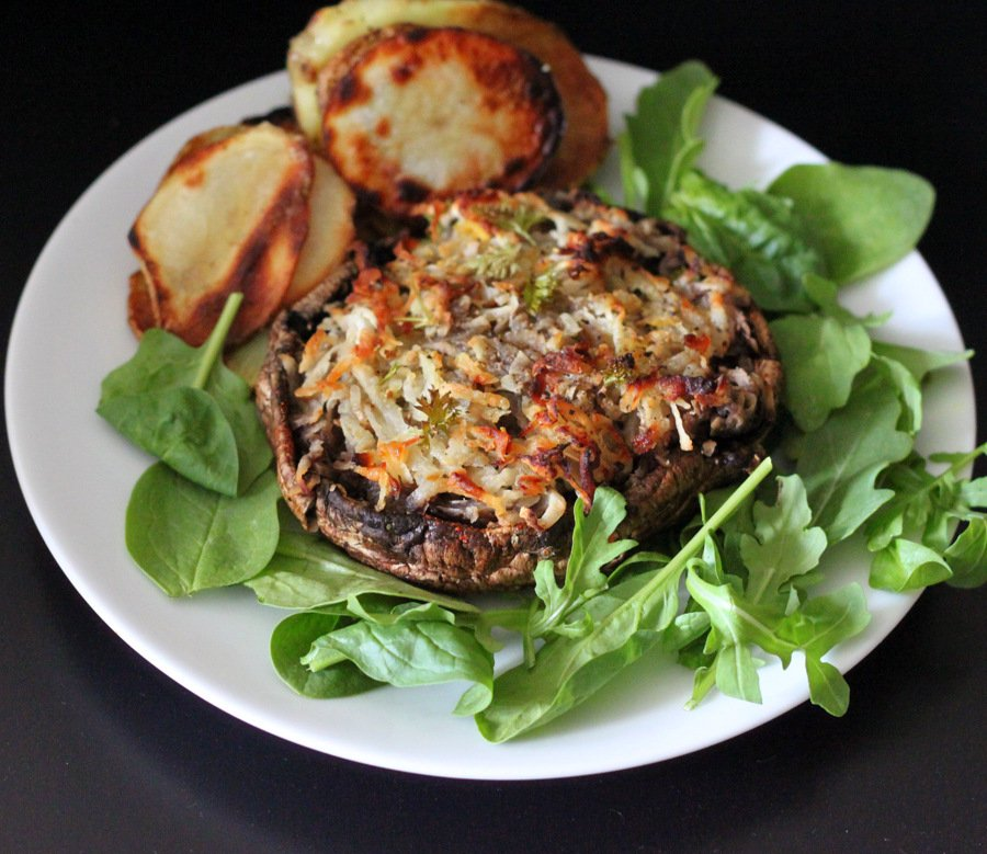 Portabella stuffed with Hash browns. Cheesy russet potato shreds stuffed in mushrooms and baked. | VeganRicha.com #vegan #glutenfree #breakfast