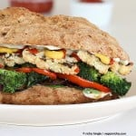 side view close-up of roasted vegan vegetable sandwich with sriracha mayo
